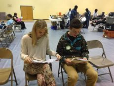 Juniors Ally Chebuhar and Alex Hardie read over the information packet. Photo Credit: Mrs. Murchison