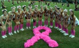 The girls support breast cancer awareness with a pink out themed football game! Photo credit: Mr. Mackey