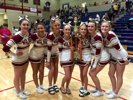The girls holding the first place trophy they won at Woodstock High School on October 24.